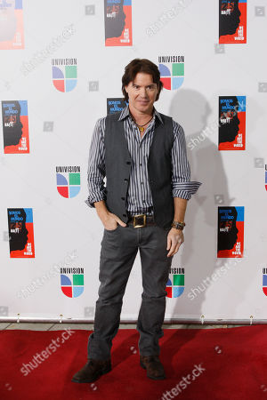 "Arthur Hanlon Pianist Arthur Hanlon poses for photographers on the red carpet as he goes in to record the Spanish language version of ""We Are The World"" (Somos el Mundo) with other top Latin music artists in Miami"