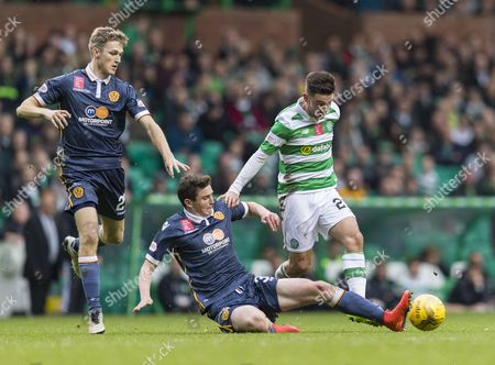 Stock Image of Patrick Roberts of Celtic tackled by Jake Hastie of Motherwell with David Ferguson of Motherwell (l) during the SPFL Ladbrokes Premiership match between Celtic & Motherwell at Celtic Park on 15th October