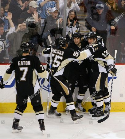Chris Kunitz, Bill Guerin, Sergei Gonchar, Mark Eaton Pittsburgh Penguins' Chris Kunitz, center, is greeted by teammates Bill Guerin (13), Sergei Gonchar (55), of Russia, and Mark Eaton (7) after scoring his second goal, in the third period of an NHL hockey game in Pittsburgh, . The Penguins won 3-1