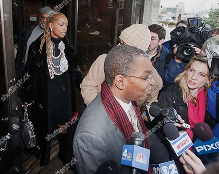 """Members of the news media interview DeForest Buster Sores, Williams' spiritual advisor, as Williams' wife Tanya Young Williams, left, exits the Somerville, NJ courthouse on after Williams' sentencing in the 2002 fatal shooting of Costas """"Gus"""" Christofi. Superior Court Judge Edward Coleman sentenced Williams to five years in prison with a minimum of 18 months before he is eligible for parole"""