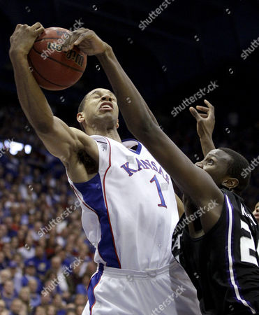 Xavier Henry Kansas' Xavier Henry (1) puts up a shot under pressure from Kansas State's Travis Releford during the second half of an NCAA college basketball game, in Lawrence, Kan. Kansas won 82-65