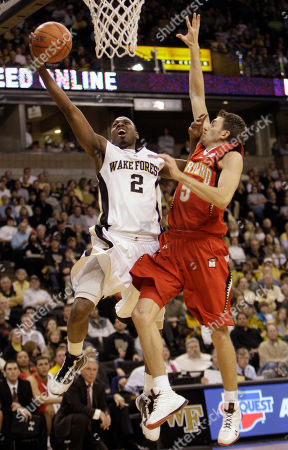 Gary Clark, Eric Hayes Wake Forest's Gary Clark (2) drives past Maryland's Eric Hayes (5) during the first half of an NCAA college basketball game in Winston-Salem, N.C