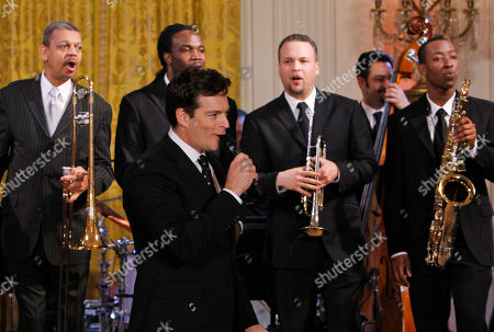 Harry Connick Jr., Lucien Barbarin, Shamarr Allen, Mark Braud, Neal Caine, Calvin Johnson Jr Harry Connick Jr., sings during a special preview for local music students, of the talent performing at the White House annual Governors Ball, at the White House in Washington . Behind him are Lucien Barbarin, left, Shamarr Allen, Mark Braud, Neal Caine on bass, and Calvin Johnson Jr., far right