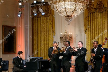 Harry Connick Jr., Lucien Barbarin, Shamarr Allen, Mark Braud, Calvin Johnson Jr Harry Connick Jr., right, performs during a special preview for local music students, of the talent performing at the White House annual Governors Ball, at the White House in Washington, . With him are Lucien Barbarin, left, Shamarr Allen, Mark Braud, and Calvin Johnson Jr