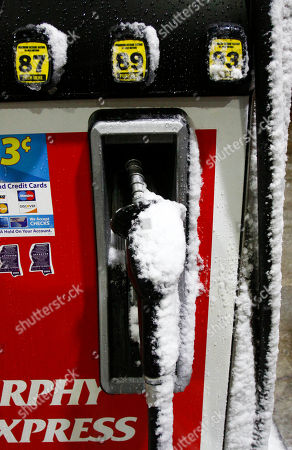 Snow and ice decorate this gas pump at a Murphy Express filling station in north Jackson, Miss., early Friday morning, . Much of Mississippi is expected to receive several inches of snow by mid-morning, and Gov. Haley Barbour declared a state of emergency on Thursday in anticipation of the winter storm which is expected to force dozens of school cancellations and close some businesses