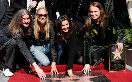 """Wesley Orbison Alex Orbison Barbara Orbison Roy Orbison Jr Rock and roll legend Roy Orbison is honored with a star posthumously on the Hollywood Walk of Fame, with family members, from left, sons Wesley, Alex, wife Barbara Orbison, and Roy Jr. in the Hollywood section of Los Angeles. Orbison's three sons are all musicians but never really got to play music with their dad - until now. Wesley, Roy Jr. and Alex Orbison have helped create a new song by their father that will appear on the 25th anniversary reissue and expansion of Orbison's final album, """"Mystery Girl"""" that is being re-released on May 20, 2014"""