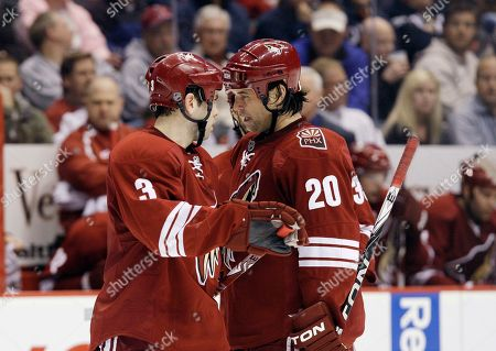 Robert Lang, Keith Yandle Phoenix Coyotes' Robert Lang (20), of the Czech Republic, talks strategy with teammate Keith Yandle (3) in the second period of an NHL hockey game against the Edmonton Oilers, in Glendale, Ariz. The Coyotes defeated the Oilers 6-1