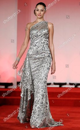 """Oday Shakar A model wearing a dress by Oday Shakar walks the runway during the """"Oscars Designer Challenge 2010"""" fashion show at the Academy of Motion Picture Arts and Sciences in Beverly Hills, Calif. on"""