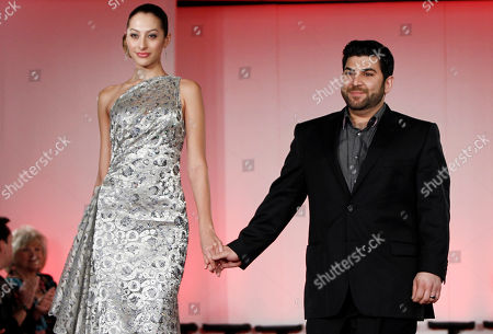 Oday Shakar Designer Oday Shakar, right, walks the runway with a model wearing his design during the Oscars Designer Challenge 2010 fashion show at the Academy of Motion Picture Arts and Sciences in Beverly Hills, Calif. on
