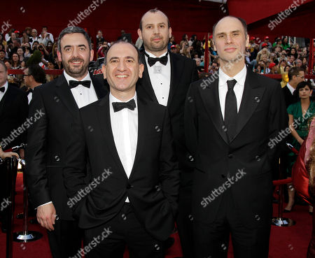 """In The Loop"""" writing nominees, from left, Tony Roche, Armando Ianucci, Simon Blackwell, and Jesse Armstrong arrive at the 82nd Academy Awards, in the Hollywood section of Los Angeles"""