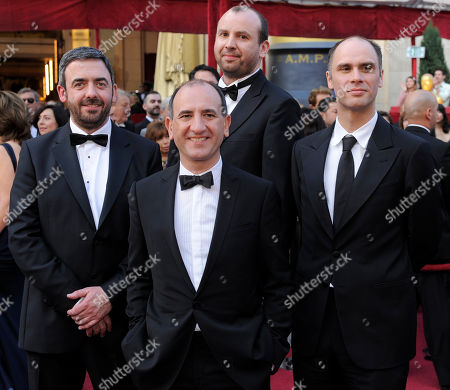 """In The Loop"""" writing nominees, from left, Toney Roche, Armando Ianucci, Simon Blackwell and Jesse Armstrong arrive at the 82nd Academy Awards, in the Hollywood section of Los Angeles"""