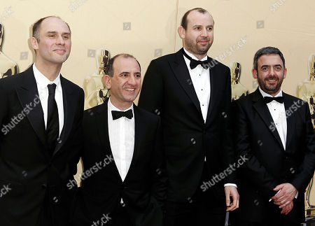 """In The Loop"""" writing nominees, from right, Toney Roche, Simon Blackwell, Armando Ianucci and Jesse Armstrong arrive during the 82nd Academy Awards, in the Hollywood section of Los Angeles"""