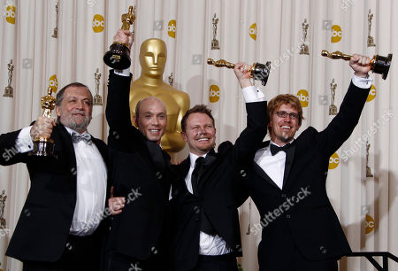 """Stock Picture of Joe Letteri, Stephen Rosenbaum, Andrew R. Jones, Richard Baneham From left, Joe Letteri, Stephen Rosenbaum, Andrew R. Jones and Richard Baneham pose backstage with the Oscar for best achievement in visual effects for """"Avatar"""" at the 82nd Academy Awards, in the Hollywood section of Los Angeles"""