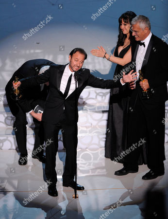 """Fisher Stevens, Paula DuPre Pesmen, Louie Psihoyos From left are Fisher Stevens, Paula DuPre Pesmen, and Louie Psihoyos are seen on stage as the accept the award for best documentary feature for """"The Cove"""" at the 82nd Academy Awards, in the Hollywood section of Los Angeles"""