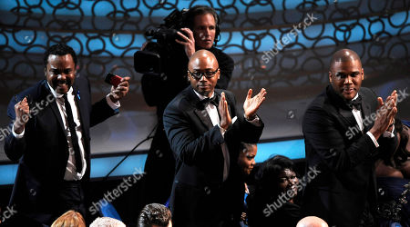 """Lee Daniels, Sidney Hicks, Tyler Perry Lee Daniels, left,Sidney Hicks, center, and Tyler Perry react as Geoffrey Fletcher wins the Oscar for best adapted screenplay for """"Precious: Based on the Novel 'Push' by Sapphire"""" during the 82nd Academy Awards, in the Hollywood section of Los Angeles"""