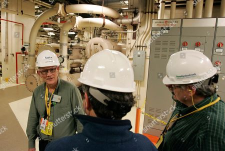Exelon's David Benson, left, talks about machinery in the turbine building at the Oyster Creek nuclear generating plant, in Forked River, N.J