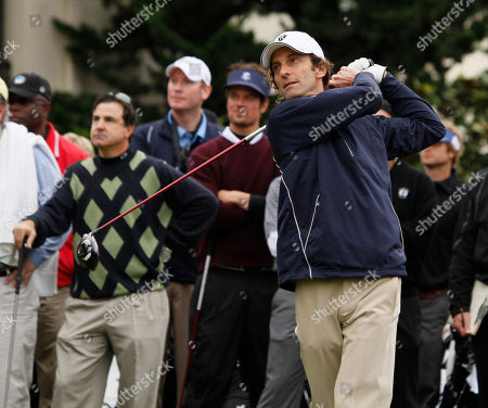 Kenny G, Jackie Flynn Musician Kenny G hits from the first tee of the Pebble Beach Golf Links during the celebrity challenge event at the AT&T Pebble Beach National Pro-Am in Pebble Beach, Calif., . At left is comedian Jackie Flynn