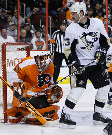 Bill Guerin, Ray Emery Philadelphia Flyers goalie Ray Emery, left, blocks a shot as Pittsburgh Penguins forward Bill Guerin looks on in the first period of an NHL hockey game, in Philadelphia