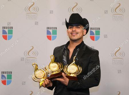 Espinoza Paz Mexican singer Espinoza Paz poses for photographers backstage at the Premio Lo Nuestro Latin music awards show, in Miami
