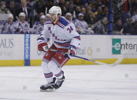 Aaron Voros New York Rangers' Aaron Voros is seen during the first period of an NHL hockey game against the St. Louis Blues, in St. Louis