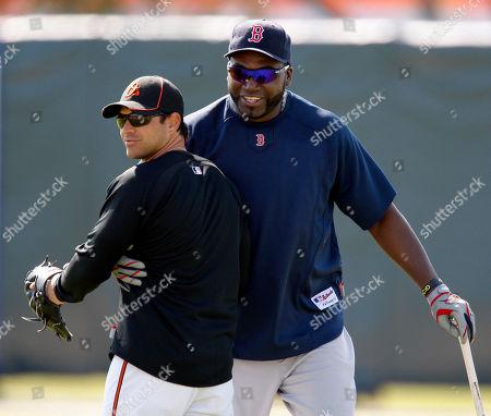Brian Roberts, Davi Ortiz Boston Red Sox first baseman David Ortiz, right, grabs Baltimore Orioles second baseman Brian Roberts (1) during pre-game warmups before their spring training baseball game at Ed Smith Stadium in Sarasota, Fla