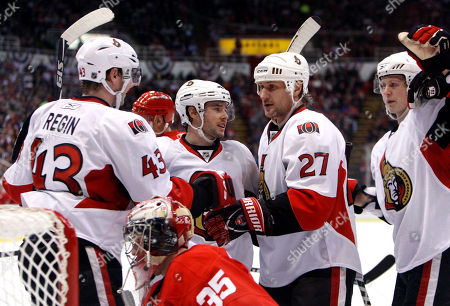 Peter Regin, Ryan Shannon, Alexei Kovalev, Brian Lee Ottawa Senators center Peter Regin (43), of Denmark, celebrates his goal with teammates winger Ryan Shannon, second from left, winger Alexei Kovalev (27), of Russia, and defenseman Brian Lee, right, in front of Detroit Red Wings goalie Jimmy Howard (35) during the second period of an NHL hockey game, in Detroit