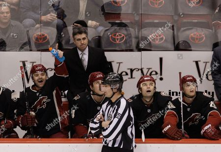 Mark Wheeler, Dave Tippett, Vernon Fiddler, Taylor Pyatt, Robert Lang, Lauri Korpikoski Phoenix Coyotes' Vernon Fiddler, left, yells at officials to look at the video on the scoreboard as head coach Dave Tippett, top, and Coyotes' players Taylor Pyatt, second from left, Robert Lang (20), of the Czech Republic, and Lauri Korpikoski, right, of Finland, look on as lineman Mark Wheeler (56) skates past in the first period of an NHL hockey game against the Dallas Stars, in Glendale, Ariz. The Stars defeated the Coyotes 3-0