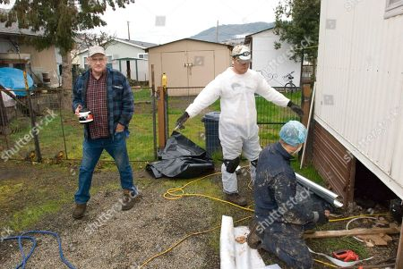 Richard Briggs watches progress on weatherization on his home in Roseburg, Ore., while workers Jason Shoopman, center, and Phil Seal, both of Roseburg, discuss what to do next. The worst recession in 70 years is turning into an energy-saving boon for tiny and remote rural schools in Oregon as well as the state's poorest people. Federal economic stimulus money is paying for new energy-efficient lights and windows in schools that have not been modernized since they were built after World War II, and in houses and apartments where people struggle to pay their utility bills
