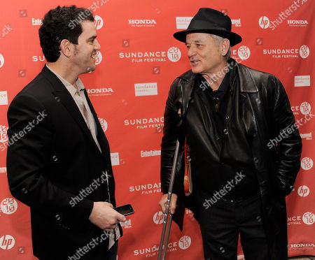 "Aaron Schneider, Bill Murray Aaron Schneider, left, director of ""Get Low,"" greets cast member Bill Murray at the premiere of the film during the Sundance Film Festival in Park City, Utah"