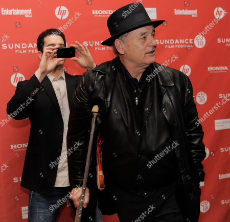 "Aaron Schneider, Bill Murray Get Low"" director Aaron Schneider, left, photographs cast member Bill Murray as he arrives at the premiere of the film during the Sundance Film Festival in Park City, Utah"