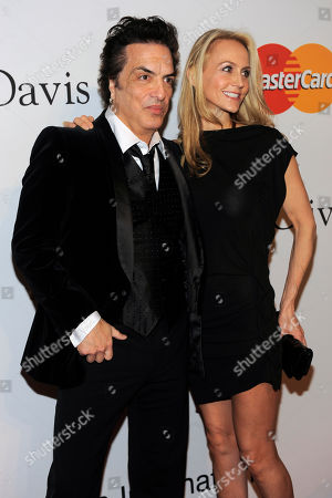 Paul Stanley, Erin Sutton Paul Stanley, left, and Erin Sutton arrive at the annual Pre-GRAMMY Gala presented by The Recording Academy and Clive Davis on at The Beverly Hilton Hotel in Beverly, Hills, California