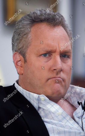 Andrew Breitbart Conservative online publisher Andrew Breitbart is seen during an interview with the Associated Press at his home in Los Angeles . Shirley Sherrod, who was ousted from her job at the Agriculture Department, said Thursday she will sue Breitbart for posting an edited video of her making racially tinged remarks last week