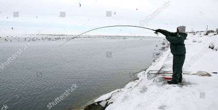 Guy Wilson, 40, fishes off the banks of Lake Erie, in Cleveland. Wilson said he comes to this spot to fish every morning