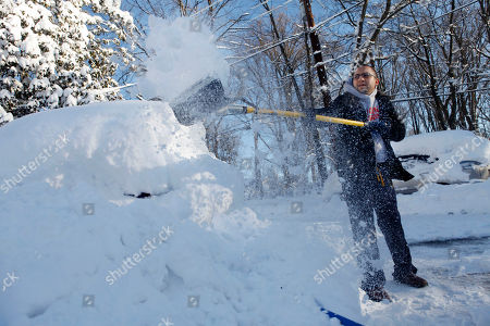 "John Ibrahim, digs out his car at his home that has been without power since Friday night in Silver Spring, Md. on . A massive snow storm hit the region Friday and Saturday, dumping 2 feet of snow in some places. ""At least if we clean off the cars we can get some heat and charge the cell phones,"" says Ibrahim"