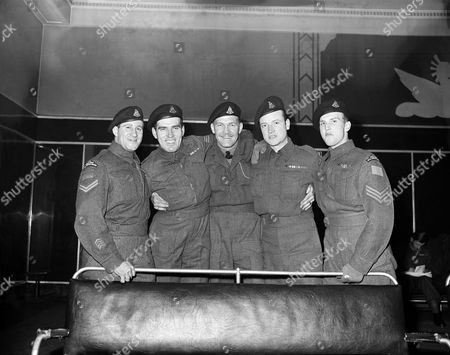 Stock Image of Homeward bound are these Montreal veterans, part of the largest contingent of Canadian troops ever to arrive in the port of New York, who disembarked from the Liner Queen Elizabeth on December 28. From Left to Right are Corp. Thomas Tate, Sgt. Harry Smith, Sgt. Maj. Walter Newbury, Corp. Ray Johnson and Sgt. Leslie Stevenson. The liner brought 12,461 passengers, including 10,516 Canadian troops