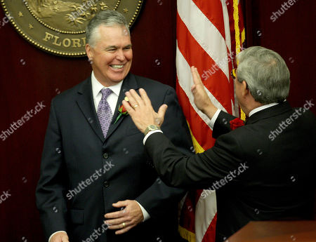 Ron Reagan, Larry Cretul Rep. Ron Reagan, R-Bradenton, left, and House Speaker Larry Cretul, R-Ocala, share a moment duuring opening day ceremonies of the Florida Legislature, in Tallahassee, Fla