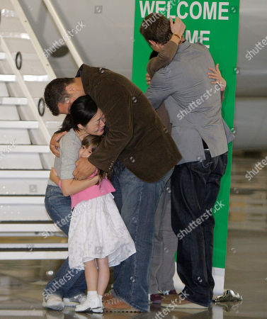 Stock Photo of Laura Ling, Euna Lee Euna Lee, left, and Laura Ling, second from right, two American journalists who were arrested in March after allegedly crossing into North Korea from China, are greeted by Michael Saldate, the husband of Euna Lee, center, Ian Clayton, the husband of Laura Ling, right, and Lee's daughter, Hana, after the two arrived at Bob Hope Airport in Burbank, Calif
