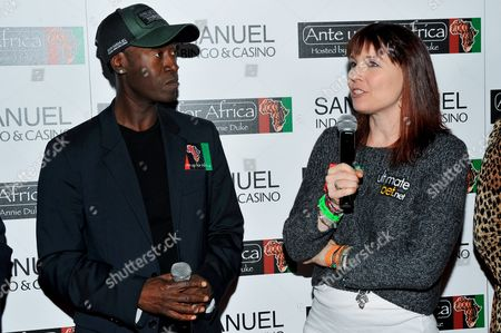 Don Cheadle, Annie Duke L-R) Actor Don Cheadle and professional poker player Annie Duke pose for a photograph at the 2nd Annual Ante Up for Africa poker tournament to benefit Darfur at San Manuel Indian Bingo & Casino in Highland, California on October 29th, 2009