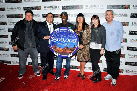 Don Cheadle, James Ramos, Annie Duke, Lyn Valbuena, Norman Epstein, James LeRoy L-R) Tribe Business Committee member James LeRoy, San Manuel Tribe Chairman James Ramos, actor Don Cheadle, Vice Chairwoman of the Tribal Business Committee Lyn Valbuena, professional poker player Annie Duke, and Co-Founder of Ante Up for Africa Norman Epstein pose for a photograph at the 2nd Annual Ante Up for Africa poker tournament to benefit Darfur at San Manuel Indian Bingo & Casino in Highland, California on October 29th, 2009