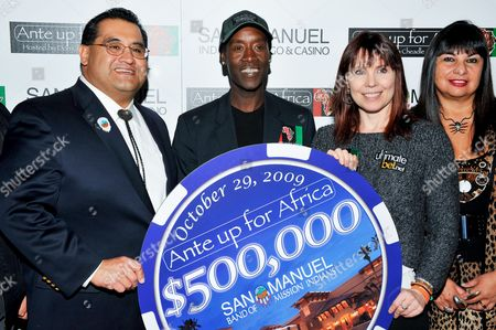Don Cheadle, James Ramos, Annie Duke, Lyn Valbuena L-R) San Manuel Tribe Chairman James Ramos, actor Don Cheadle, professional poker player Annie Duke, and Vice Chairwoman of the Tribal Business Committee Lyn Valbuena pose for a photograph at the 2nd Annual Ante Up for Africa poker tournament to benefit Darfur at San Manuel Indian Bingo & Casino in Highland, California on October 29th, 2009