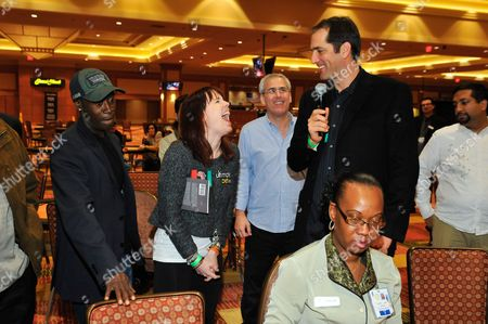 Stock Image of Marlon Maglaya, Norman Epstein, Don Cheadle, Annie Duke Actor Don Cheadle, third place winner Marlon Maglaya. professional poker player Annie Duke, Co-Founder of Ante Up for Africa Norman Epstein pose for a portrait during the 2nd Annual Ante Up for Africa poker tournament to benefit Darfur at San Manuel Indian Bingo & Casino in Highland, California on October 29th, 2009