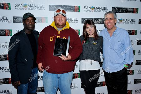 Joshua Draney, Norman Epstein, Don Cheadle, Annie Duke Actor Don Cheadle, tournament runner up Joshua Draney, professional poker player Annie Duke, Co-Founder of Ante Up for Africa Norman Epstein pose with awards during the 2nd Annual Ante Up for Africa poker tournament to benefit Darfur at San Manuel Indian Bingo & Casino in Highland, California on October 29th, 2009