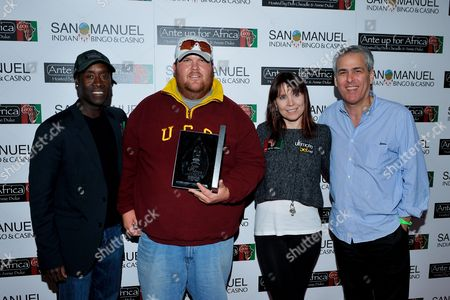 Stock Photo of Joshua Draney, Norman Epstein, Don Cheadle, Annie Duke Actor Don Cheadle, tournament runner up Joshua Draney, professional poker player Annie Duke, Co-Founder of Ante Up for Africa Norman Epstein pose with awards during the 2nd Annual Ante Up for Africa poker tournament to benefit Darfur at San Manuel Indian Bingo & Casino in Highland, California on October 29th, 2009