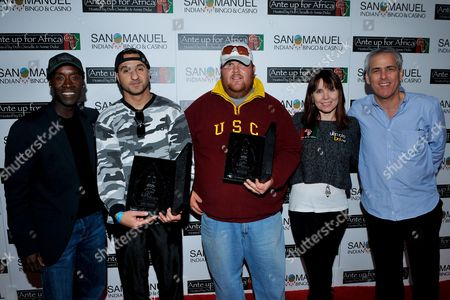 Ali Akhyari, Joshua Draney, Norman Epstein, Don Cheadle, Annie Duke Actor Don Cheadle, tournament champion Ali Akhyari, runner up Joshua Draney, professional poker player Annie Duke, Co-Founder of Ante Up for Africa Norman Epstein pose with awards during the 2nd Annual Ante Up for Africa poker tournament to benefit Darfur at San Manuel Indian Bingo & Casino in Highland, California on October 29th, 2009