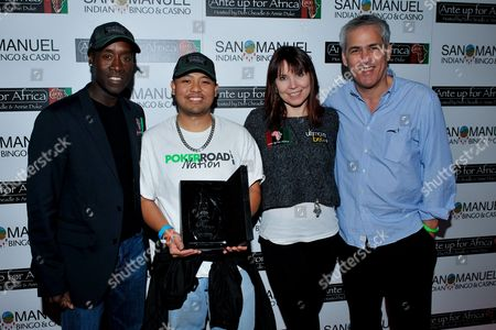 Stock Picture of Marlon Maglaya, Norman Epstein, Don Cheadle, Annie Duke Actor Don Cheadle, tournament champion Ali Akhyari, third place winner Marlon Maglaya, professional poker player Annie Duke, Co-Founder of Ante Up for Africa Norman Epstein pose wiht awards during the 2nd Annual Ante Up for Africa poker tournament to benefit Darfur at San Manuel Indian Bingo & Casino in Highland, California on October 29th, 2009