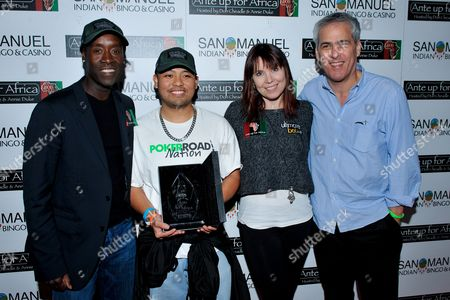Marlon Maglaya, Norman Epstein, Don Cheadle, Annie Duke Actor Don Cheadle, third place winner Marlon Maglaya. professional poker player Annie Duke, Co-Founder of Ante Up for Africa Norman Epstein pose for a portrait during the 2nd Annual Ante Up for Africa poker tournament to benefit Darfur at San Manuel Indian Bingo & Casino in Highland, California on October 29th, 2009