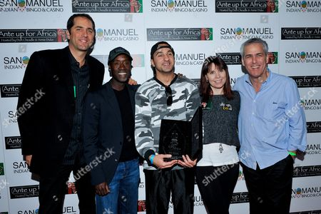 Ali Akhyari, Norman Epstein, Don Cheadle, Annie Duke, Phil Gordon Professional poker player Phil Gordon, Actor Don Cheadle, tournament champion Ali Akhyari, runner up Joshua Draney, professional poker player Annie Duke, Co-Founder of Ante Up for Africa Norman Epstein pose with awards during the 2nd Annual Ante Up for Africa poker tournament to benefit Darfur at San Manuel Indian Bingo & Casino in Highland, California on October 29th, 2009