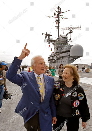 "Buzz Aldrin, Lisa Cannon Col. Buzz Aldrin, former Apollo 11 lunar module pilot, gestures beside his step daughter Lisa Cannon on the flight deck of the USS Hornet, while participating in the program, ""40 Years Later: In the Footsteps of the Apollo 11 Astronauts"", in Alameda, Calif"