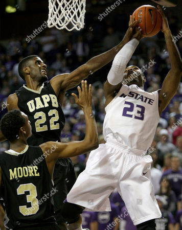 Dominique Sutton, George Davis Kansas State's Dominique Sutton (23) puts up a shot past Arkansas-Pine Bluff's George Davis (22) and Dominic Moore (3) during the first half of an NCAA college basketball game Monday, Dec, 21, 2009 in Manhattan, Kan
