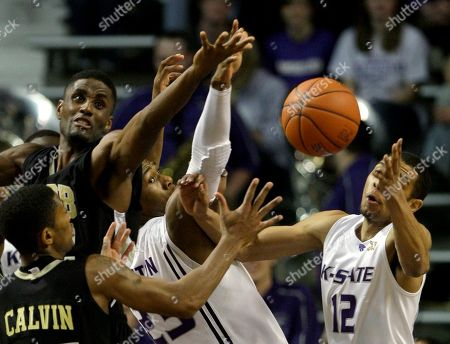 George Davis, Terrance Calvin, Nick Russell, and Dominique Sutton Arkansas-Pine Bluff's George Davis, top left, and Terrance Calvin, along with Kansas State's Nick Russell (12) and Dominique Sutton, center, battle for a loose ball during the second half of an NCAA college basketball game Monday, Dec, 21, 2009 in Manhattan, Kan. Kansas State won the game 90-76